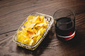Vermouth and chips classic spanish with chip potatoes on a wooden table Stock Photo