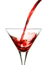 Vermouth pouring in a glass causing splash Stock Photos