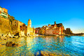 Vernazza village church rocks and sea harbor on sunset cinque seascape in five lands terre national park liguria italy europe Stock Photo
