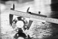 Vernier caliper measurement close up measure diameter of stainless steel flange Stock Photography