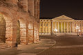 Verona arena and comune di verona building at night Stock Image
