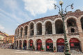 Verona arena italy – july famous roman amphitheater on piazza bra in italy with groups of tourists and surrounding Stock Image