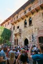 VERONA, ITALY - AUGUST 17, 2017: The house with Juliet`s balcony - Verona. Lots of tourists. Royalty Free Stock Photo