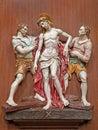 Verona jesus stripped av hans plagg en del av den keramiska cossvägen från den st nicholas kyrkan Royaltyfria Foton