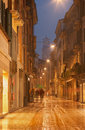 Verona via giuseppe mazzini in winter rain dusk and Royalty Free Stock Images