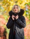 Versatile functional and stylish. Girl wear parka while walk park. Autumn season fashion concept. Puffer jacket with