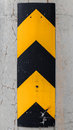 Vertical caution striped yellow and black sign on the concrete column Royalty Free Stock Images