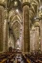Vertical of Center Nave columns and tile floor inside interior Duomo di Milano Royalty Free Stock Photo