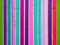 Vertical colored stripes abstract texture of a multi wall with wooden Stock Image