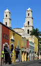 Vertical historic centro central area of historic merida mexico street leading to oldest church in the americas Stock Photography