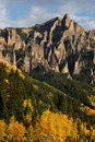 Vertical mountain crags shot of granite of peak in the fall when the aspens are turning color Royalty Free Stock Photography