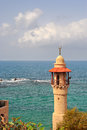 Vertical oriented image of old mosque s minaret and beautiful mediterranean sea in yafo in israel Stock Image