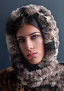 Vertical photo beautiful girl face wearing soft fur artificial fur creates fashion concept Stock Photography