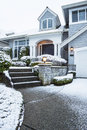 Vertical photo side walk leading to suburban home snow ground Stock Photo