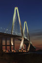 Vertical photograph illuminated arthur ravenel bridge also known as new cooper river bridge charleston south carolina dual diamond Stock Photos