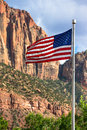 Vertical Picture of American flag with mountains in background