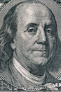 Vertical portrait of Benjamin Franklin`s face on the US 100 dollar bill. Macro shot Royalty Free Stock Photo