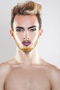 Vertical portrait of cutie young gay model with makeup and multi Royalty Free Stock Photo