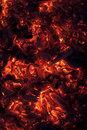 Vertical shot of glowing embers in hot red color full frame Royalty Free Stock Photos