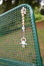 Vertical shot of a lost pacifier with a neck-chain on a park bench Royalty Free Stock Photo