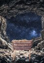 Vertical shot of a manger in a cave under a bright starry sky during the birth of Jesus Christ Royalty Free Stock Photo