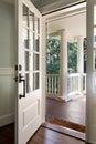 Vertical shot of an open, wooden front door Royalty Free Stock Photo
