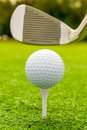 Vertical shot the putter and golf ball on a lawn Royalty Free Stock Images
