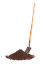 Vertical shot of shovel stuck in a pile of dirt studio isolated on white background Stock Photos