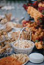 Vertical shot of wedding candy bar with nuts and pastry