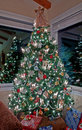 Vertical Tall Decorated Christmas Tree Indoors Royalty Free Stock Image