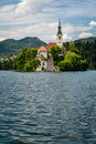 Vertical view of church of bled lake slovenia famous pilgrimage in middle is accessible only by water and steps leading to Royalty Free Stock Photos