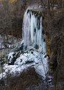 A vertical view of the frozen falling spring falls Royalty Free Stock Photo