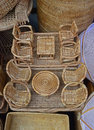 Vertical view of Miniature Rattan Set of different Coffee Table and comfortable chairs Royalty Free Stock Photo