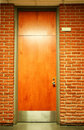 Vertical of wood door with plate Royalty Free Stock Photography
