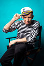Very attractive young man model dressed like a sailor - studio shoot Royalty Free Stock Photo