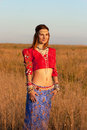 Very beautiful gipsy in the red short top Stock Images