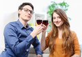 Very beautiful young couple toasting wine glasses natural portrait of Stock Photography