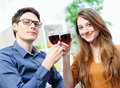 Very beautiful young couple toasting wine glasses natural portrait of Stock Photo