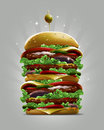 Very big cartoon style burger with olive berry and skewer