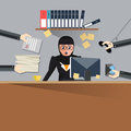 Very busy business woman working hard on her desk in office with a lot of paper work, talking on smart phone. Business concept on