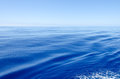 Very calm ocean with long smooth waves Stock Photo