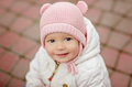 Very charming beautiful little girl with big brown eyes in a pin Royalty Free Stock Photo