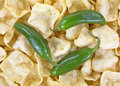 A very close view of jalapeno peppers on top of potato chips with jalapeno seasoning Stock Images
