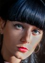 Very closeup of a young black haired women looking at camera charming woman Stock Image