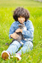 Very cute little girl with cat on meadow Royalty Free Stock Image