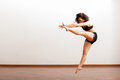 Very energetic jazz dancer beautiful latin performing a dance routine in a dance academy Stock Image