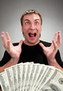 Very excited man with money Royalty Free Stock Photo