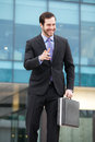 Very expresive businessman with a briefcase in front of an office building Royalty Free Stock Photo