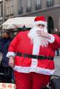Very fat santa claus on the street of the city Royalty Free Stock Photography