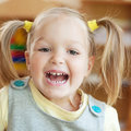 Very happy child little girl laughs Royalty Free Stock Photos
